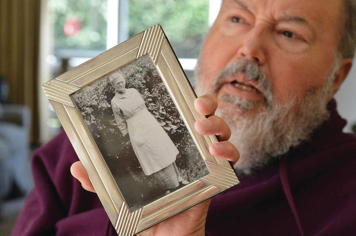 Hour photo / Alex von Kleydorff Jim Cunningham holds a photo of his great grandmother, Estella Partrick Cunningham.