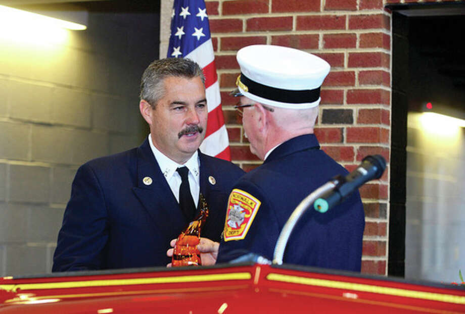 Hour photo / Erik Trautmann Norwalk Fire Chief Denis McCarthy recognizes Captain Jim Hines for his contributions as the City of Norwalk and the Fire Department formally dedicate the new Central Fire Station Saturday. / (C)2013, The Hour Newspapers, all rights reserved