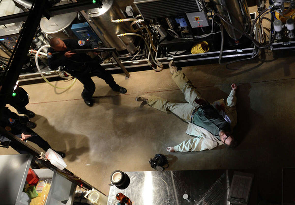 """This image released by AMC shows Bryan Cranston, as Walter White, in the final scene from """"Breaking Bad."""" The popular series about a chemistry teacher-turned drug dealer ended on Sunday, Sept 29. (AP Photo/AMC, Ursula Coyote)"""