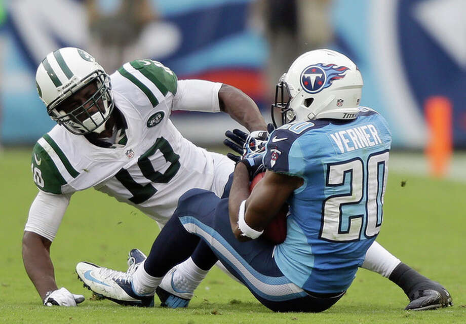 FILE - In this Sept 29, 2013, file photo, Tennessee Titans cornerback Alterraun Verner (20) intercepts a pass intended for New York Jets wide receiver Santonio Holmes (10) during the second quarter of an NFL football game in Nashville, Tenn. The Kansas City Chiefs and the Titans are tied for the most takeaways in the NFL. Well, actually Titans safety Michael Griffin says it's mostly cornerback Alterraun Verner, who leads the league with six takeaways all by himself. (AP Photo/Wade Payne, File) / FR23601 AP