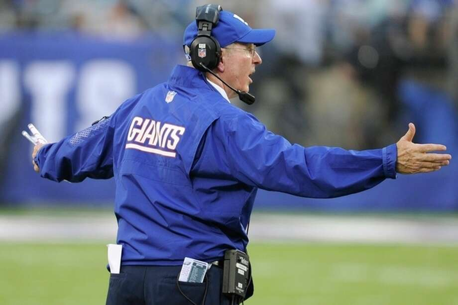 New York Giants head coach Tom Coughlin reacts during the second half of an NFL football game against the Philadelphia Eagles, Sunday, Oct. 6, 2013, in East Rutherford, N.J. (AP Photo/Bill Kostroun) / FR51951 AP