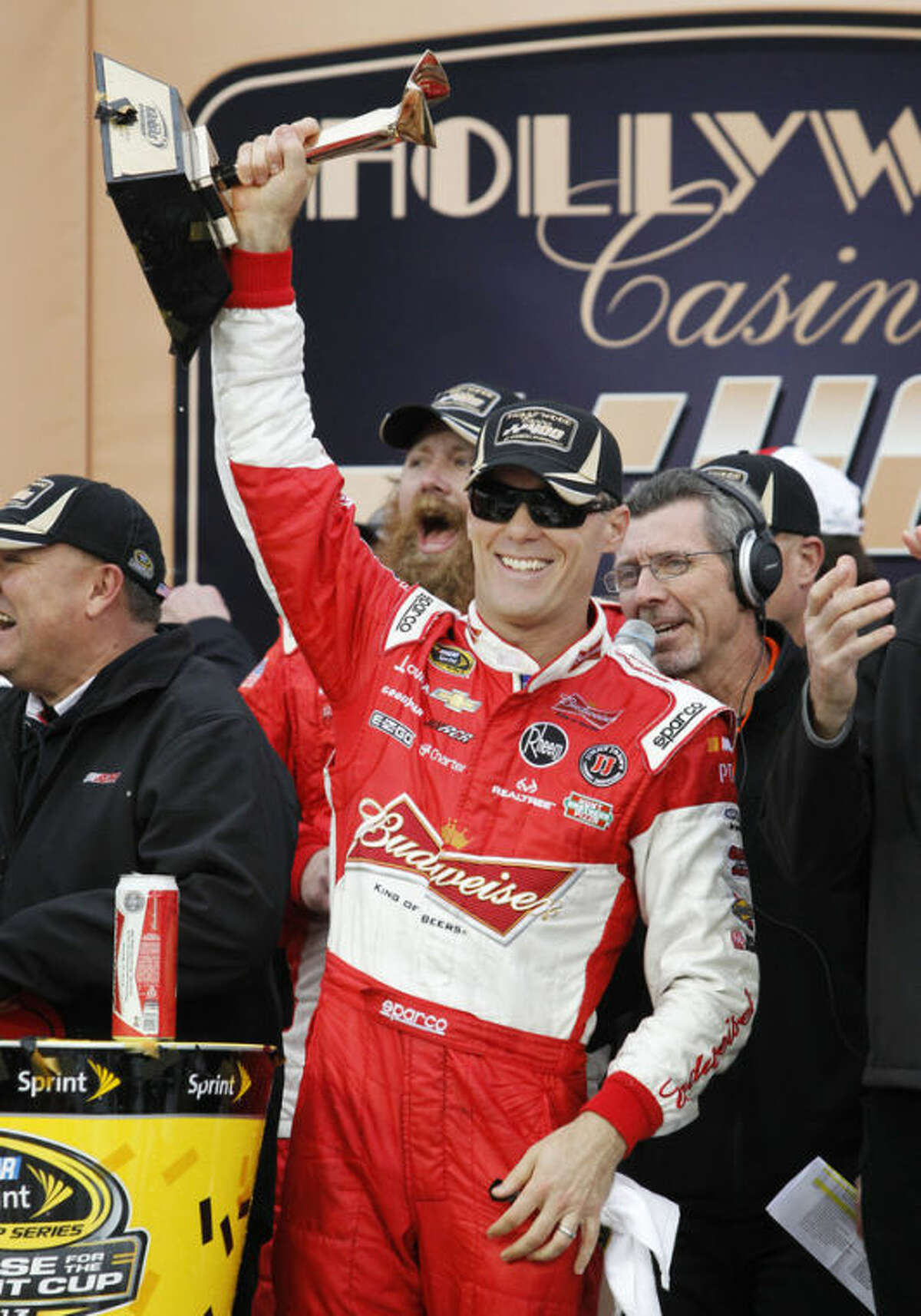 Driver Kevin Harvick celebrates in victory lane after winning the Hollywood Casino 400 NASCAR Sprint Cup series auto race at Kansas Speedway in Kansas City, Kan., Sunday, Oct. 6, 2013. (AP Photo/Colin E. Braley)