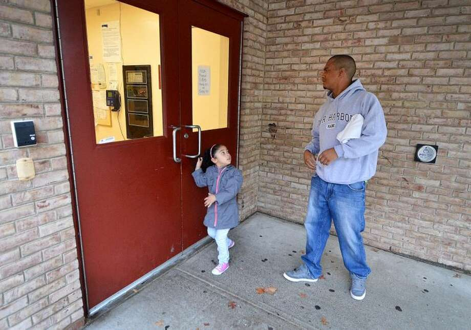 Hour Photo/Alex von Kleydorff The door is locked and a sign posted at Nathaniel Ely School that the NEON Child Development program is closed Monday and Tuesday.