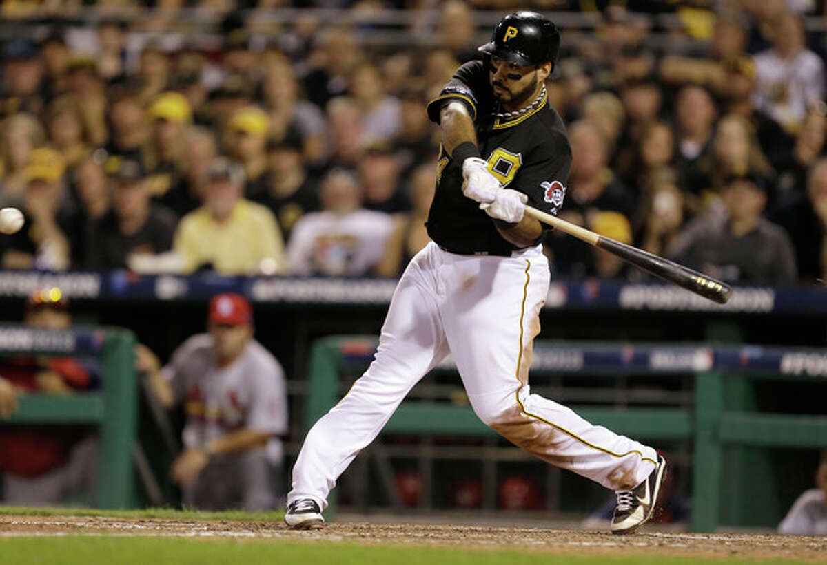 Pittsburgh Pirates' Pedro Alvarez drives in Josh Harrison with the go-ahead run with a single to right field in the eighth inning of Game 3 of a National League division baseball series against the St. Louis Cardinals, Sunday, Oct. 6, 2013, in Pittsburgh. The Pirates won 5-3 to take a two games to one lead in the best-of-five series. (AP Photo/Gene J. Puskar)