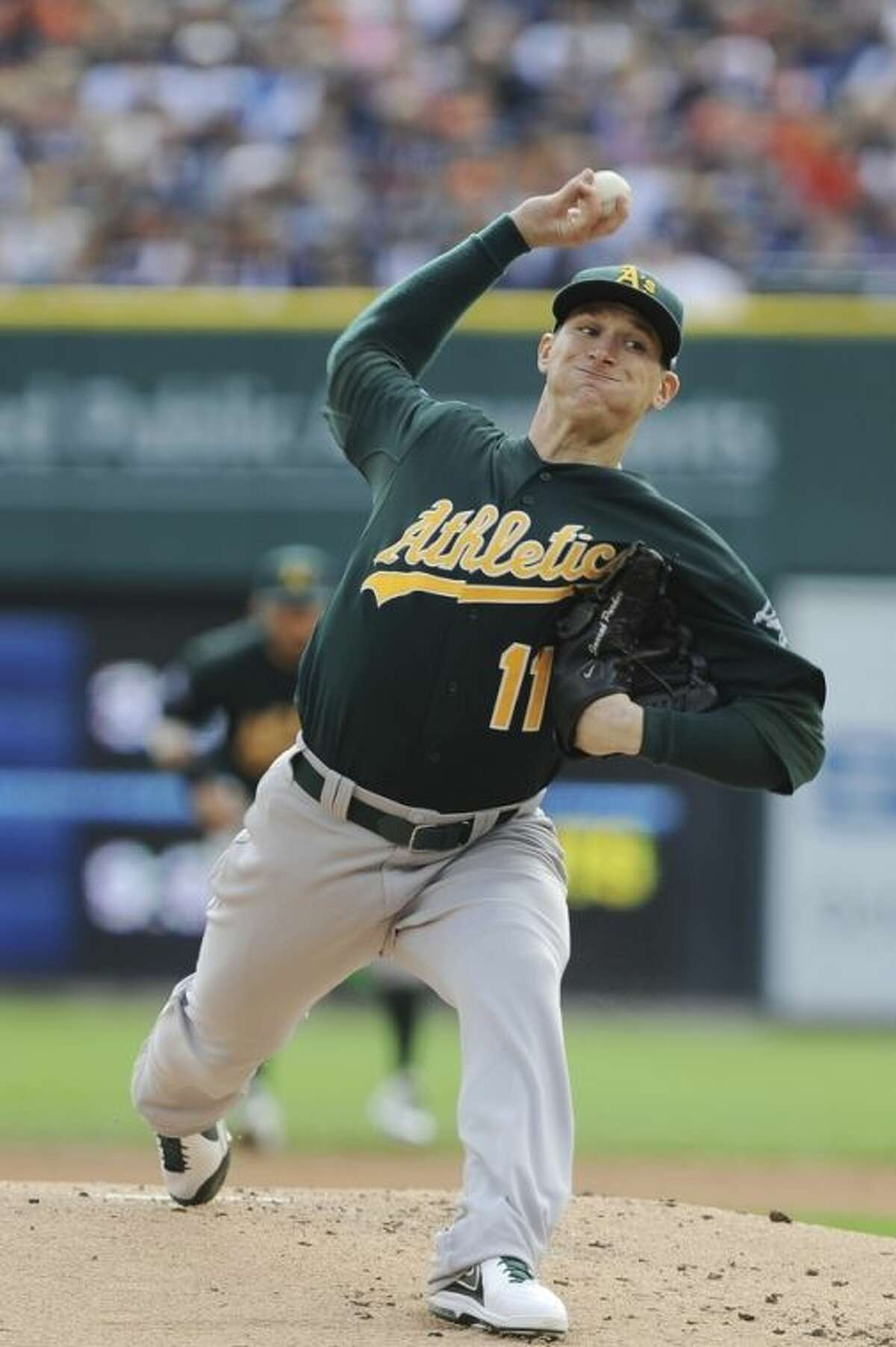 Oakland Athletics starting pitcher Jarrod Parker throws during the first inning of Game 3 of an American League baseball division series against the Detroit Tigers in Detroit, Monday, Oct. 7, 2013. (AP Photo/Lon Horwedel)