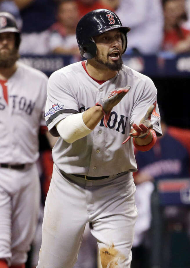 Boston Red Sox's Shane Victorino applauds teammate David Ortiz after Victorino scored on a hit by Ortiz in the fifth inning in Game 3 of an American League baseball division series against the Tampa Bay Rays, Monday, Oct. 7, 2013, in St. Petersburg, Fla. (AP Photo/Chris O'Meara)