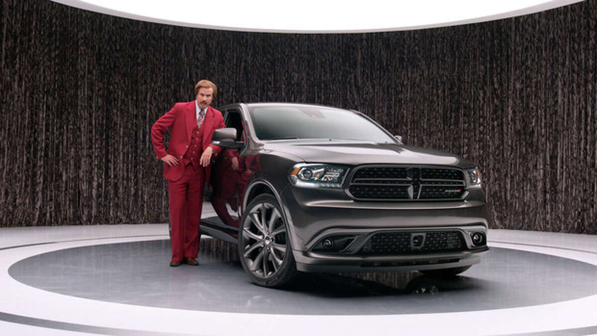 """This undated photo provided by Chrysler shows Will Farrell as the 'Anchorman' character Ron Burgundy as part of the new 2014 Dodge Durango advertisement. The campaign, scheduled to appear on TV until the sequel """"Anchorman 2: The Legend Continues"""" makes its debut around Christmas, could alienate those didn't see the first movie or those who didn't like it. (AP Photo/Chrysler)"""