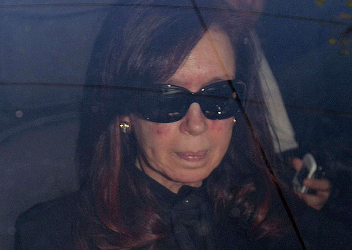 ALTERNATIVE CROP TO EDB101 - Argentina's President Cristina Fernandez arrives to a local hospital, in Buenos Aires, Argentina, Monday, Oct. 7, 2013. Argentine president is back in the hospital, presumably for more treatment of the head injury that prompted doctors to order a month's rest. Her car entered the Fundacion Favaloro hospital on Monday, as Cabinet members gathered without her in the government palace for a speech by Vice President Amado Boudou, who wished her strength and said they would carry on,