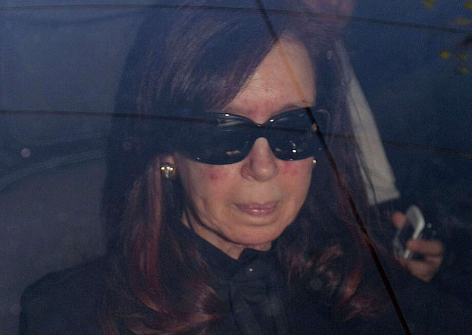 "ALTERNATIVE CROP TO EDB101 - Argentina's President Cristina Fernandez arrives to a local hospital, in Buenos Aires, Argentina, Monday, Oct. 7, 2013. Argentine president is back in the hospital, presumably for more treatment of the head injury that prompted doctors to order a month's rest. Her car entered the Fundacion Favaloro hospital on Monday, as Cabinet members gathered without her in the government palace for a speech by Vice President Amado Boudou, who wished her strength and said they would carry on, ""giving her the rest she deserves."" (AP Photo/DyN, Pablo Molina) / DyN"