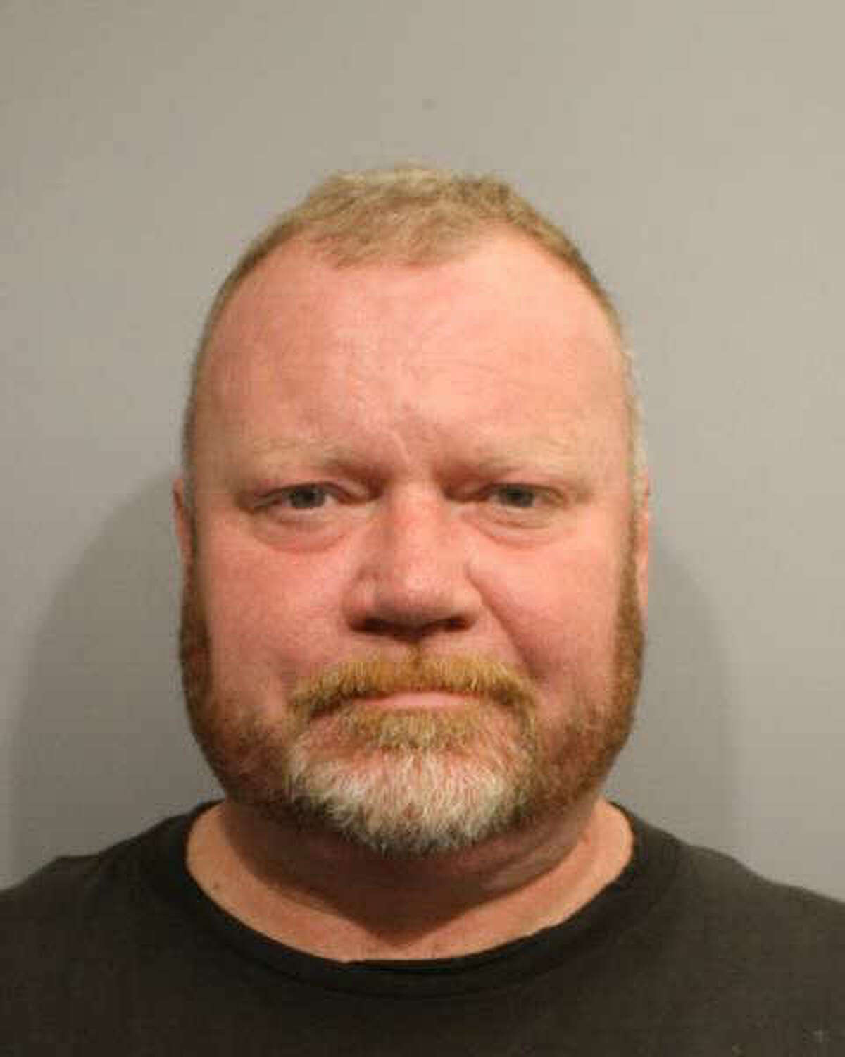 This booking photo provided by the Wilton Police Department shows Eivind Heggland. Heggland is accused of punching his son in the arm and pulling his hair last month.