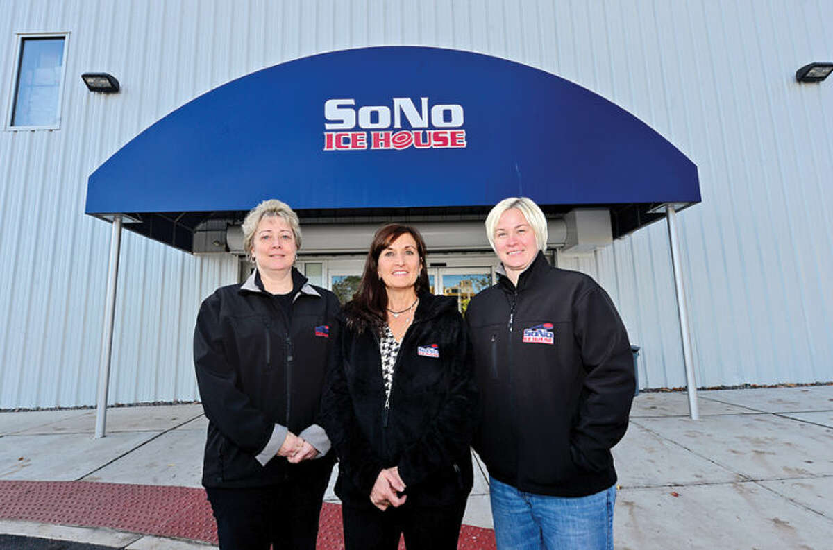 Hour photo / Erik Trautmann Francine Ehrlich, Dale DeRosa and Melissa Hawkins, employees of the SoNo Icehouse who make the business run but are seldom seen by most of the patrons.