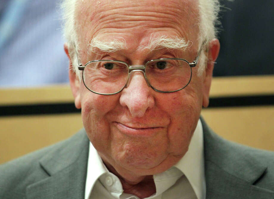 FILE - In this Wednesday, July 4, 2012 file photo British physicist Peter Higgs arrives for a scientific seminar to deliver the latest update in the search for the Higgs boson at the European Organization for Nuclear Research (CERN) in Meyrin near Geneva, Switzerland. Francois Englert and Peter Higgs were awarded the Nobel physics prize on Tuesday Oct. 8, 2013. (AP Photo/Denis Balibouse, Pool) / POOL
