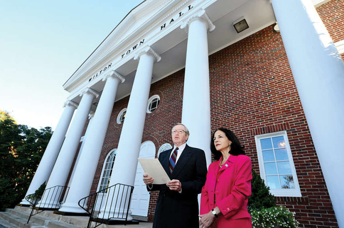 Hour photo / Erik Trautmann State Representative Gail Lavielle (R-143) stands beside Wilton First Selectman Bill Brennan as he reads a domestic violation proclamation outside Town Hall Tuesday announcing October as Domestic Violence Awareness Month.
