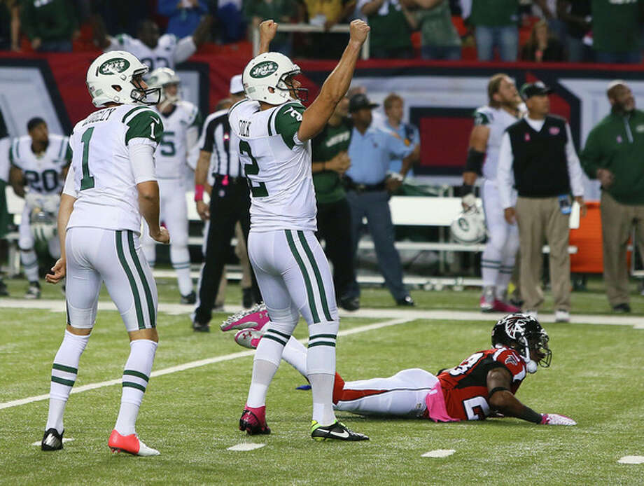 New York Jets kicker Nick Folk reacts to his game-winning field goal, as Atlanta Falcons' Robert Alford lies on the ground, having missed the block attempt in the fourth quarter of an NFL football game Monday, Oct. 7, 2013, in Atlanta. (AP Photo/Atlanta Journal Constitution, Curtis Compton) GWINNETT OUT MARIETTA OUT LOCAL TV OUT (WXIA, WGCL, FOX 5) / Atlanta Journal Constitution