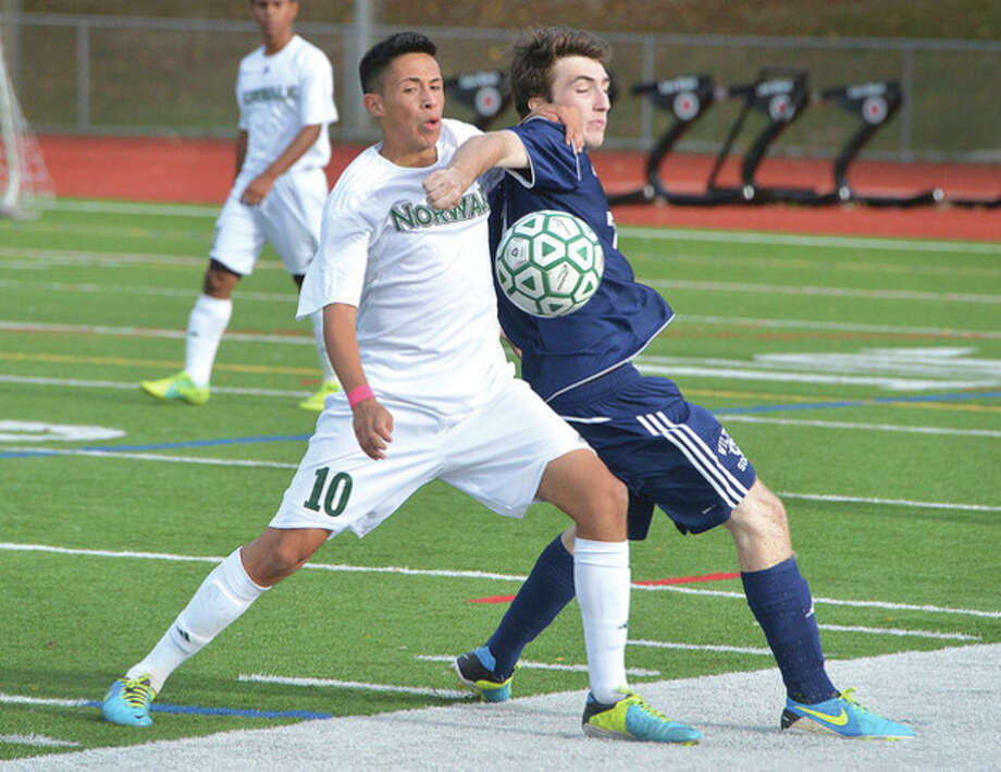 Hour photo/Alex von KleydorffNorwalk's Jon Ceja, left, and Brendan Devane of Wilton mix it up as they battle for the ball during Tuesday afternoon's game at Testa Field in Norwalk. The two teams battled to a 1-1 draw.