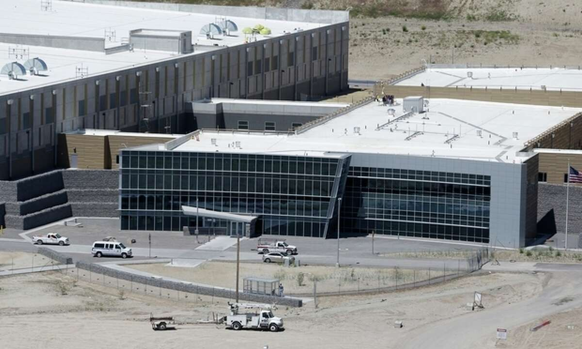 FILE - A June 6, 2013, file photo, is an aerial view of the NSA's Utah Data Center in Bluffdale, Utah. Electrical failures are complicating the opening of the National Security Agency?'s largest data storage center. The Army Corps of Engineers says it discovered the problem during tests ahead the fall opening of the $1.7 billion facility located south of Salt Lake City on a National Guard base. (AP Photo/Rick Bowmer, File)
