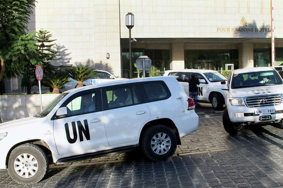 A convoy of chemical weapons disarmament experts depart the Four Seasons Hotel in Damascus, Syria, Tuesday, Oct. 8, 2013. The joint OPCW-U.N. mission to scrap Syria's chemical program stems from a deadly Aug. 21 attack on opposition-held suburbs of Damascus in which the U.N. has determined the nerve agent sarin was used. Hundreds of people were killed, including many children.(AP Photo) / AP