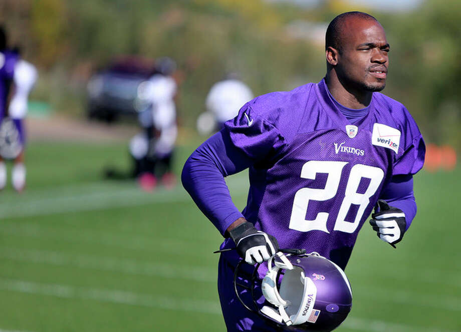 Minnesota Vikings' Adrian Peterson makes his way off an NFL football practice field at Winter Park in Eden Prairie, Minn., Friday, Oct. 11, 2013. Peterson said he is certain he will play Sunday despite a serious personal matter that caused him to miss practice earlier this week. (AP Photo/The Star Tribune, Elizabeth Flores) ST. PAUL PIONEER PRESS OUT; SOFT OUT MINNEAPOLIS-AREA TV NOT TV OUT; MAGAZINES OUT / The Star Tribune