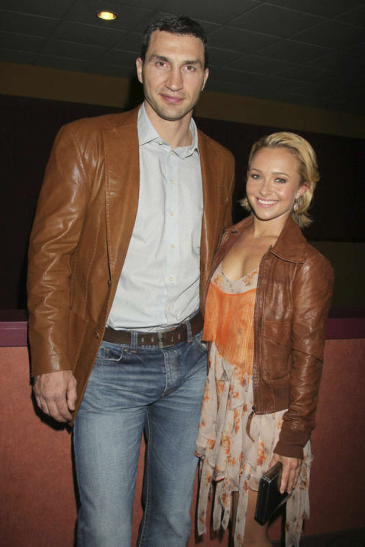 """FILE - In this April 23, 2011 file photo released by Starpix, actress Hayden Panettiere and boxer Wladimer Klitschko arrive at a Tribecca Film Festival screening of ?""""Hoodwinked Too! Hood vs. Evil,"""" in New York. Panettiere is confirming her engagement to Olympic boxer Wladimir Klitschko. Appearing on """"Live with Kelly and Michael,"""" Wednesday, Oct. 9, 2013, the 24-year-old actress was flashing a large diamond ring that prompted host Kelly Ripa to inquire what it might signify. (AP Photo/Starpix, Davre Allocca, File)"""