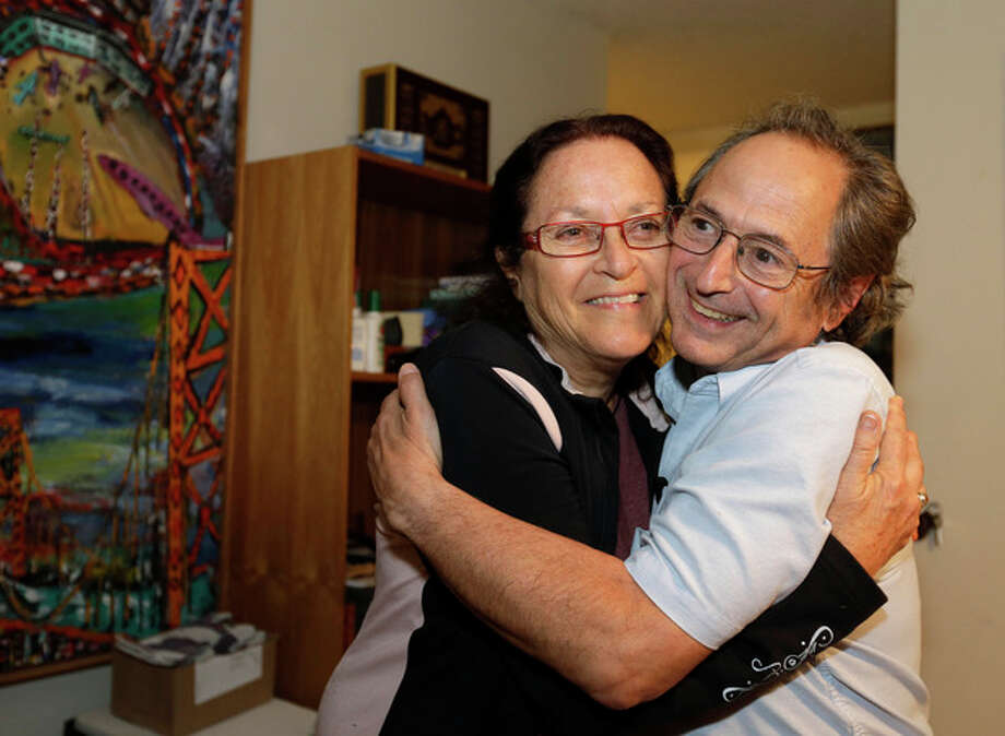 Stanford University professor Michael Levitt, who won the Nobel Prize in chemistry, is embraced by his wife Rina at their home on Wednesday, Oct. 9, 2013, in Stanford, Calif. Three U.S.-based scientists won this year's Nobel Prize in chemistry for developing powerful computer models that researchers use to understand complex chemical interactions and create new drugs. Research in the 1970s by Levitt, Martin Karplus and Arieh Warshel led to programs that unveil chemical processes such as how exhaust fumes are purified or how photosynthesis takes place in green leaves. (AP Photo/Eric Risberg) / AP