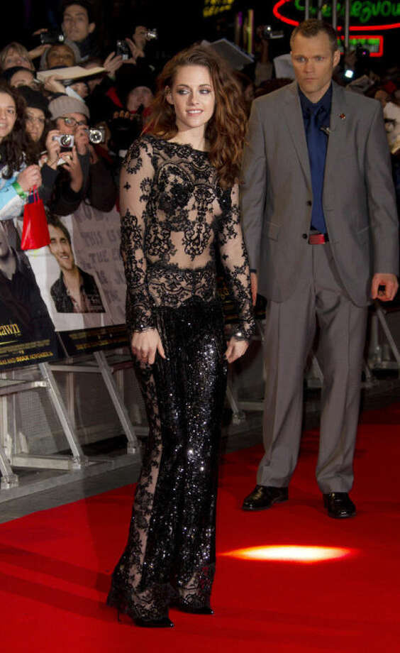 "FILE - This Nov. 14, 2012 file photo shows actress Kristen Stewart in a gown by Zuhair Murad at the European premiere of ""The Twilight Saga: Breaking Dawn Part 2,"" in Leicester Square, central London. (Photo by Joel Ryan/Invision/AP, File)"