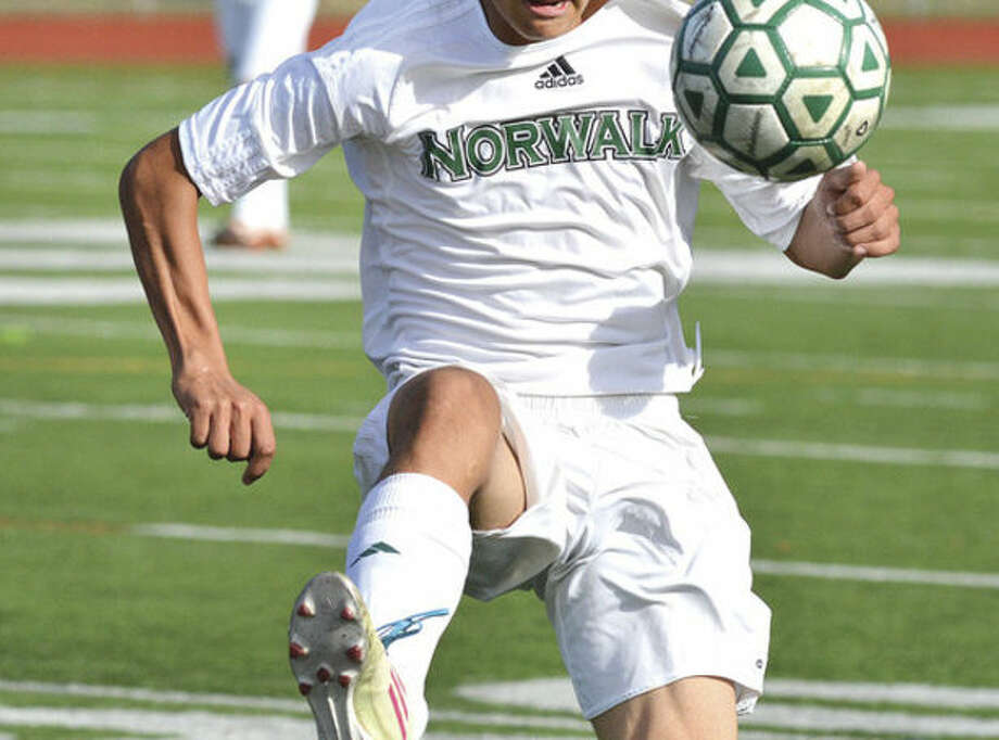 Hour photo/Alex von KleydorffNorwalk's Patrick Barrantes tries to comtrol the ball during Tuesday's game against Wilton. The two area rivals battled to a 1-1 tie.