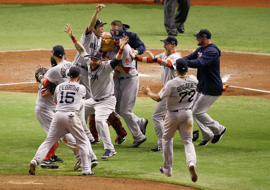Boston Red Sox players celebrate after defeating the Tampa Bay Rays 3-1 to win baseball's American League division series, Tuesday, Oct. 8, 2013, in St. Petersburg, Fla. (AP Photo/John Raoux) / AP