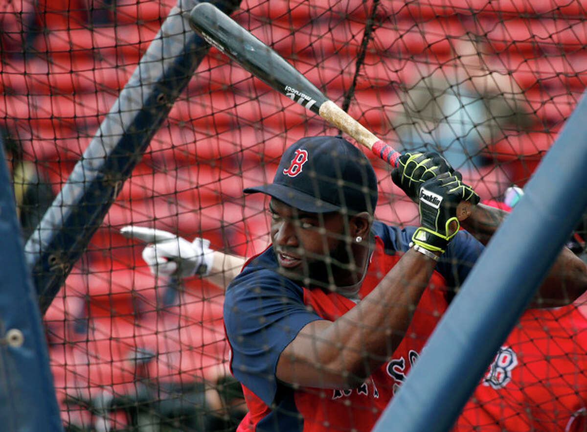 Boston Red Sox designated hitter David Ortiz practices in the batting cage during a baseball team workout at Fenway Park in Boston, Thursday, Oct. 10, 2013, in preparation for Game 1 of the ALCS, Saturday. (AP Photo/Elise Amendola)