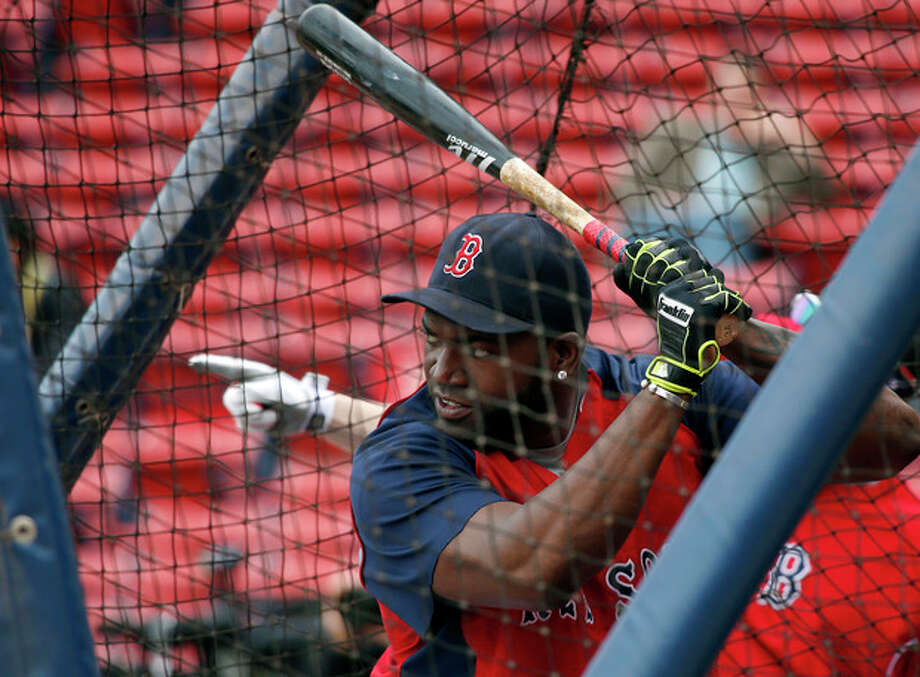 Boston Red Sox designated hitter David Ortiz practices in the batting cage during a baseball team workout at Fenway Park in Boston, Thursday, Oct. 10, 2013, in preparation for Game 1 of the ALCS, Saturday. (AP Photo/Elise Amendola) / AP