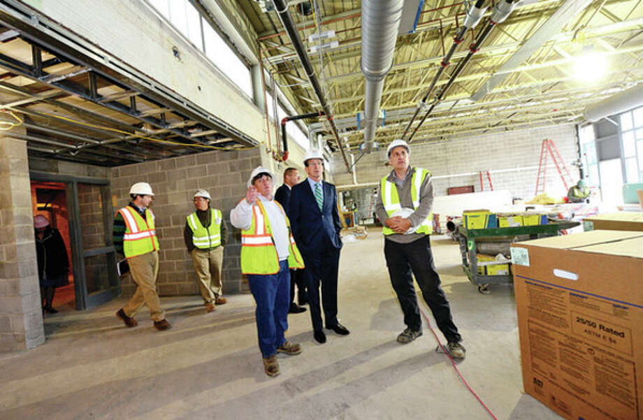 Hour photo / Erik TrautmannCT Governor Dannel Malloy is led on a tour by KBE Project Superintendent Bob Smedley and CT DCS Dennis Tovey following the ground breaking ceremony at Wright Technical School in Satmford Thursday. / (C)2013, The Hour Newspapers, all rights reserved