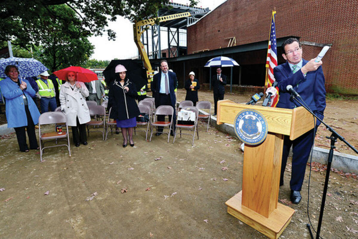 Hour photo / Erik Trautmann CT Governor Dannel Malloy speaks at the ground breaking ceremony at Wright Technical School in Stamford Thursday.