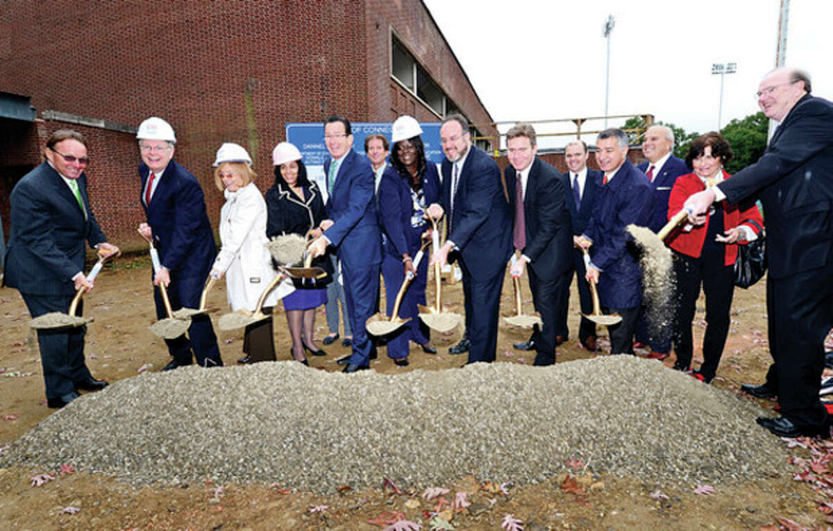 Hour photo / Erik Trautmann Gov. Dannel Malloy and other dignitaries shovel dirt a ground breaking ceremony at Wright Technical School in Satmford Thursday.