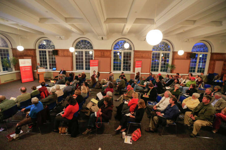 Chris Palermo / Hour Photo. A crowd packs the City Hall Community Room for the overview of the healthcare reform put on by Access Health CT Thursday night. / © 2013 Hour Newspapers All Rights Reserved