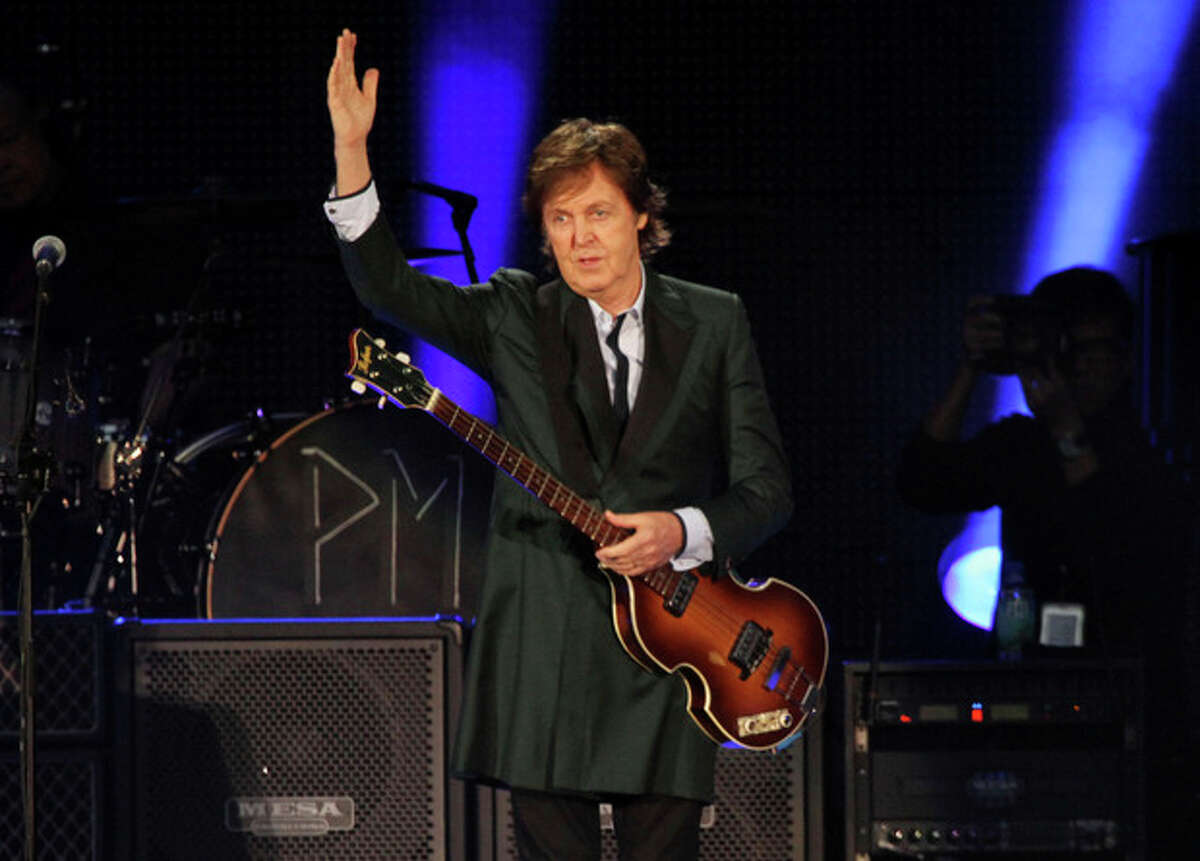 """FILE - This July 9, 2013 file photo shows Paul McCartney performing at Fenway Park in Boston, Mass. McCartney celebrated his 2-year wedding anniversary with his wife and few hundred students.The 71-year-old performed at the Frank Sinatra School of the Arts in the borough of Queens on Wednesday. McCartney said ?""""happy anniversary baby?"""" to Nancy Shevell before going into his latest song, ?""""New.?"""" (Photo by Marc Andrew Deley/Invision/AP, File)"""