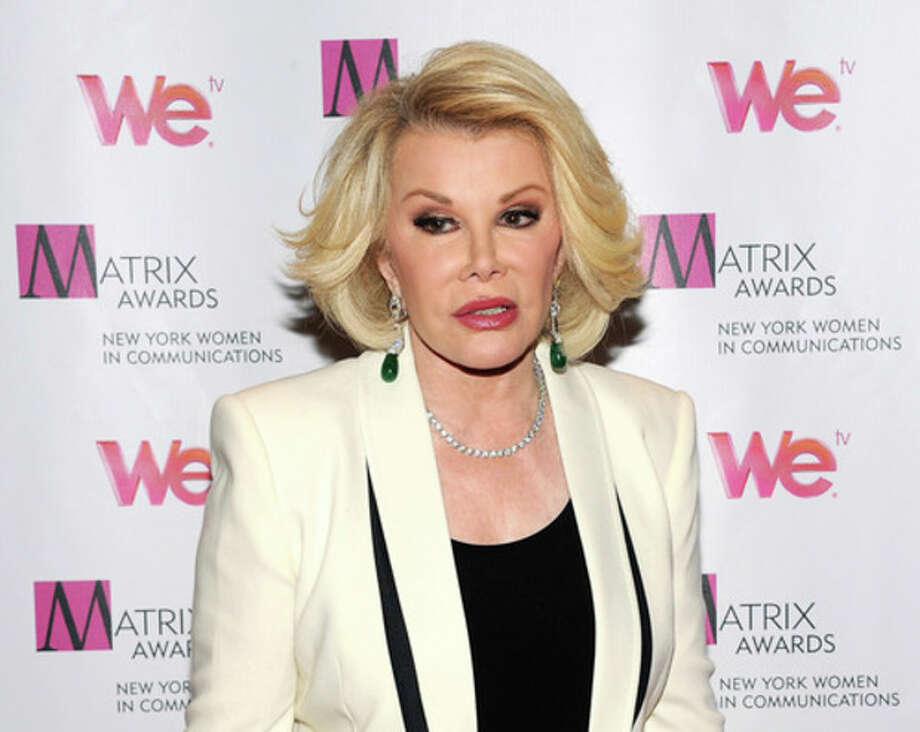 FILE - In this April 22, 2013 file photo, Television personality Joan Rivers attends the 2013 Matrix New York Women in Communications Awards at the Waldorf-Astoria Hotel, in New York. The comedian and condo board president Rivers is being sued for $15 million in a dispute involving a former downstairs neighbor in her luxury New York City building. The lawsuit was filed Wednesday, Oct. 9, 2013, in state Supreme Court in Manhattan. (Photo by Evan Agostini/Invision/AP, File) / Invision