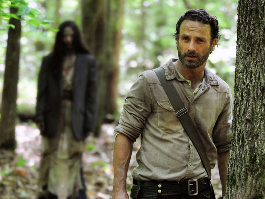 """AP Photo/AMC, Gene PageThis image released by AMC shows Andrew Lincoln as Rick Grimes in a scene from the season four premiere of """"The Walking Dead"""" airing Oct. 13 at 9 p.m. EST. / AMC"""