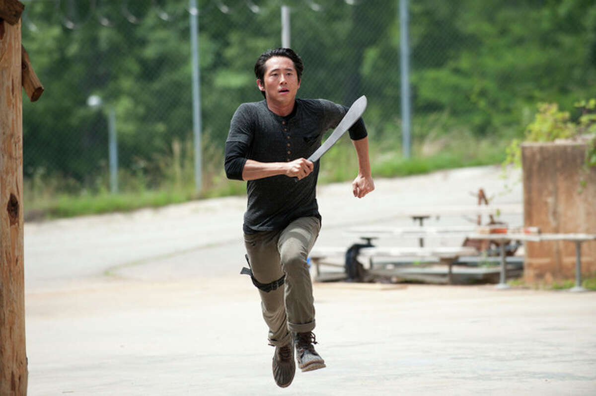 """This image released by AMC shows Steven Yeun as Glenn in a scene from """"The Walking Dead,"""" premiering Oct. 13 at 9 p.m. EST. (AP Photo/AMC, Gene Page)"""