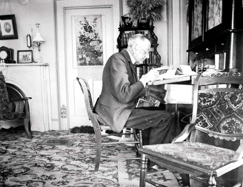 Bert Betts is shown in his home at one Allen Road in this historical photo. / (C)2013, The Hour Newspapers, all rights reserved