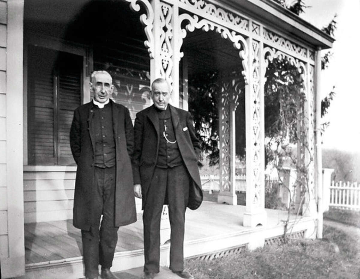 Hour photo / Erik Trautmann The Rev. Charles Selleck is shown with Bert Betts in this historical photo. Suzanne Betts is descended from several of Norwalk's founding families, including the Bettses.