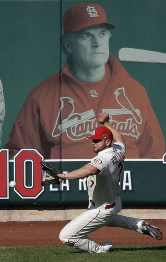 St. Louis Cardinals' Matt Holliday can't get to a ball hit by Los Angeles Dodgers' Mark Ellis during the first inning of Game 2 of the National League baseball championship series Saturday, Oct. 12, 2013, in St. Louis. (AP Photo/Charlie Neibergall)