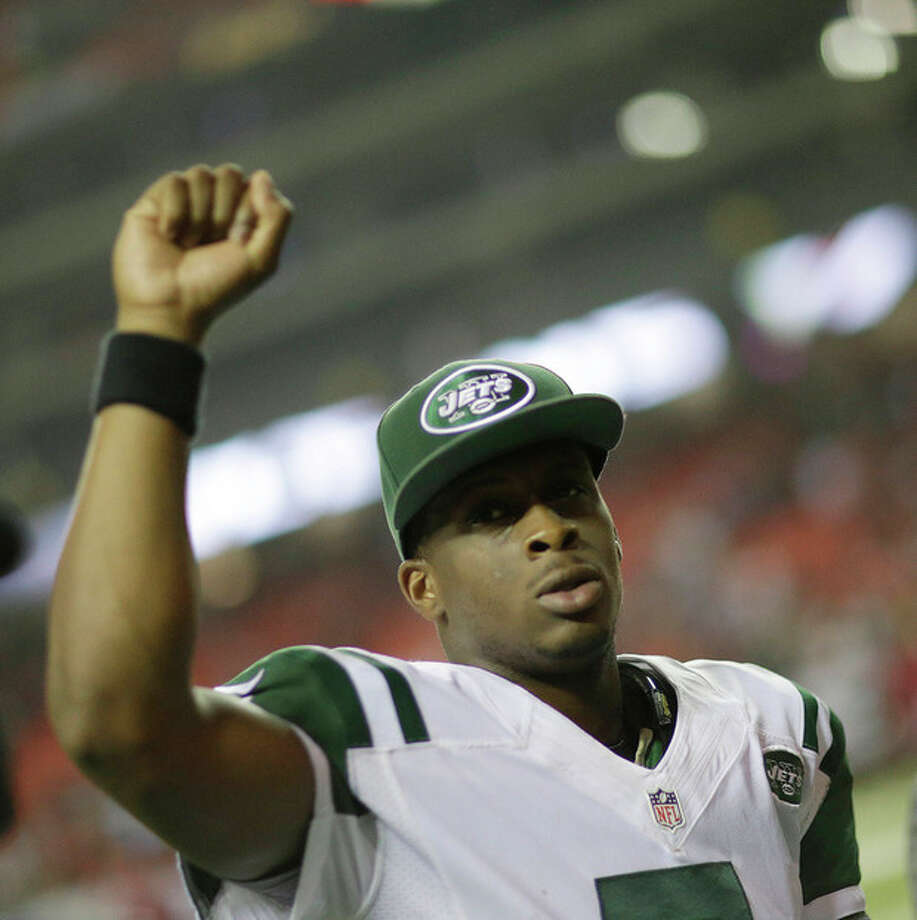 New York Jets quarterback Geno Smith celebrates after the second half of an NFL football game against the Atlanta Falcons, Monday, Oct. 7, 2013, in Atlanta. The New York Jets won 30-28. (AP Photo/David Goldman) / AP