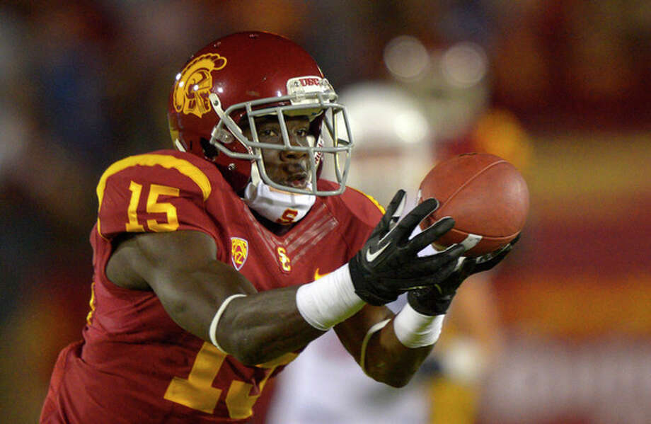 Southern California wide receiver Nelson Agholor catches a touchdown pass during the first half of an NCAA college football game against Arizona, Thursday, Oct. 10, 2013, in Los Angeles. (AP Photo/Mark J. Terrill) / AP