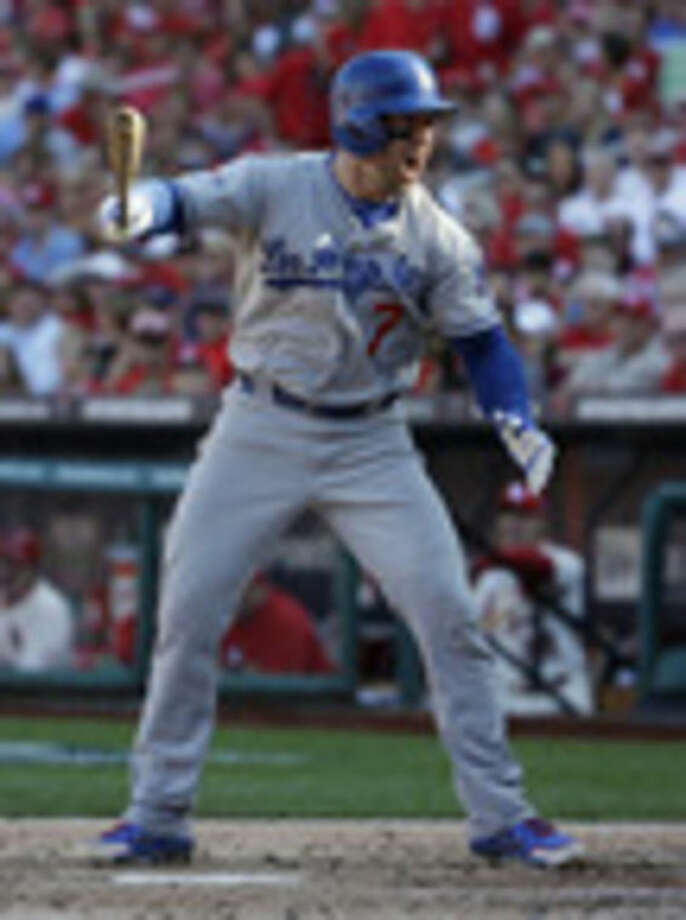 Los Angeles Dodgers' Nick Punto shouts after striking out during the third inning of Game 2 of the National League baseball championship series against the St. Louis Cardinals Saturday, Oct. 12, 2013, in St. Louis. (AP Photo/David J. Phillip)