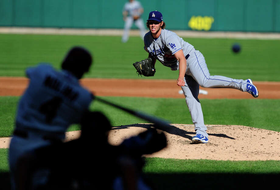Los Angeles Dodgers starting pitcher Clayton Kershaw throws to St. Louis Cardinals' Yadier Molina during the first inning of Game 2 of the National League baseball championship series Saturday, Oct. 12, 2013, in St. Louis. (AP Photo/Jeff Curry, Pool) / USA Today Sports