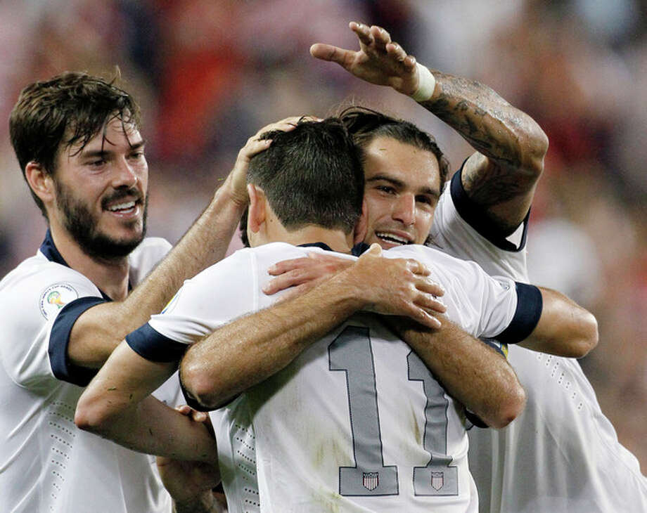 U.S. defender Brad Evans, left, midfielder Graham Zusi, center, facing camera, and midfielder Alejandro Bedoya (11) celebrate a goal in the second half of a World Cup qualifier soccer match against Jamaica at Sporting Park in Kansas City, Kan., Friday, Oct. 11, 2013. Zusi scored the goal and Bedoya got the assist in the U.S. team's 2-0 win. (AP Photo/Colin E. Braley) / FR123678 AP