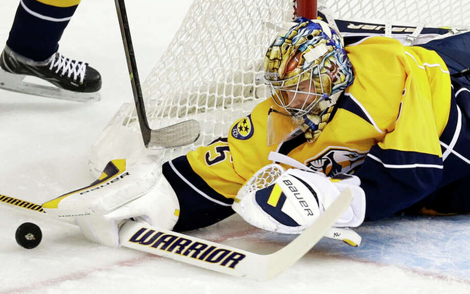 Nashville Predators goalie Pekka Rinne, of Finland, blocks a shot against the New York Islanders in the first period of an NHL hockey game on Saturday, Oct. 12, 2013, in Nashville, Tenn. (AP Photo/Mark Humphrey) / AP