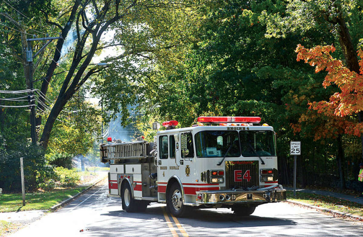 Hour photo / Erik Trautmann The Norwalk FIre Department reponds to a fire caused by electrical wires on West Rocks Rd near Blue Mountain.
