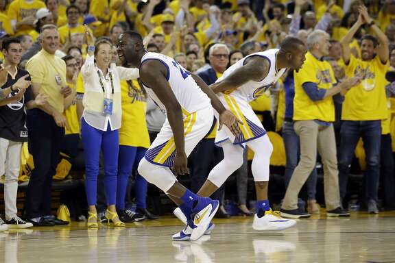 Golden State Warriors' Draymond Green, left, celebrates with teammate Andre Iguodala after a score during the second half in Game 2 of a second-round NBA basketball playoff series against the Portland Trail Blazers Tuesday, May 3, 2016, in Oakland, Calif. Golden State won 110-99. (AP Photo/Marcio Jose Sanchez)