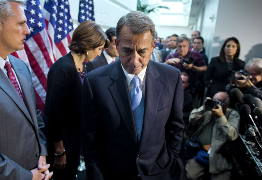 Speaker of the House Rep. John Boehner, R-Ohio, walks away from the microphone during a news conference after a House GOP meeting on Capitol Hill on Tuesday, Oct. 15, 2013 in Washington. The federal government remains partially shut down and faces a first-ever default between Oct. 17 and the end of the month. (AP Photo/ Evan Vucci) / AP