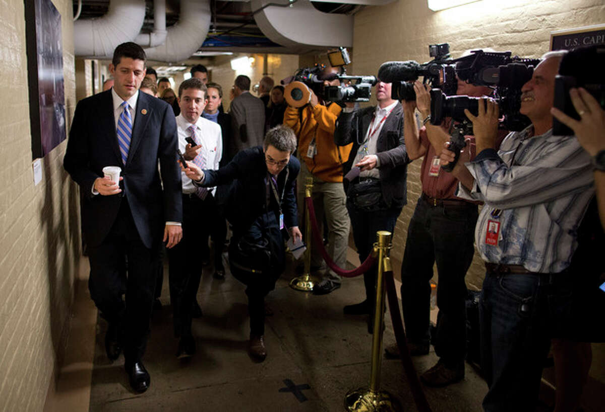 House Budget Committee chairman Rep. Paul Ryan walks to a House GOP meeting on Capitol Hill on Tuesday, Oct. 15, 2013 in Washington. The federal government remains partially shut down and faces a first-ever default between Oct. 17 and the end of the month. (AP Photo/ Evan Vucci)